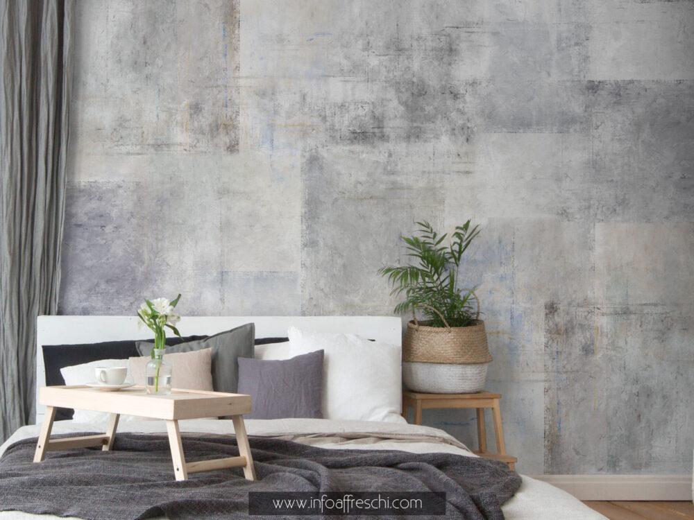 Carta da parati grigia effetto cemento per arredare le pareti di casa